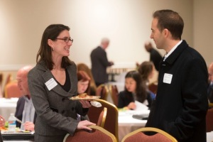 Elizabeth Rowland talks with Grant Gilreath of Jewelry TV at the TNCN-US Bank event in Knoxville in November 2015. (Photo by Saul Young for the Knoxville Business Journal)