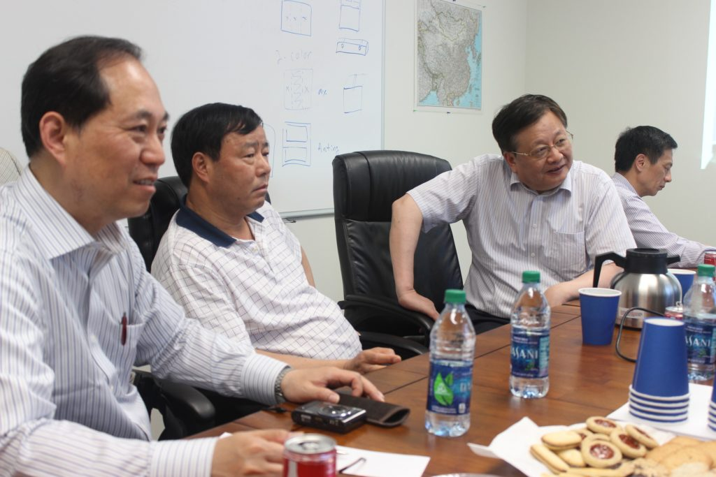 Wuxi delegation leader Mr. Jiang Da (second from left) and other delegation members meeting at Yanfeng's factory in Chattanooga.