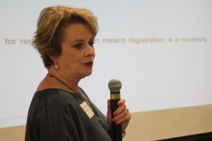 photo of Micheline Johnson of Baker Donelson presenting